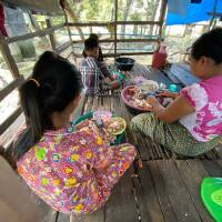 Burmese children help their parents peel crabs at their home in Ranong, Thailand on September 10, 2020. | Thomson Reuters Foundation/Nanchanok Wongsamuth