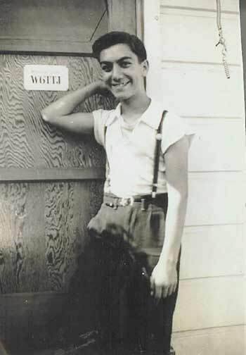 Art Laboe, age 14, standing in front of his HAM Radio shack, 1940 | Courtesy: Art Laboe Archives