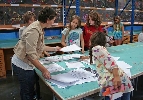 LFCSA Visual Arts Specialist Evelyn Serrano discusses the maps with the students