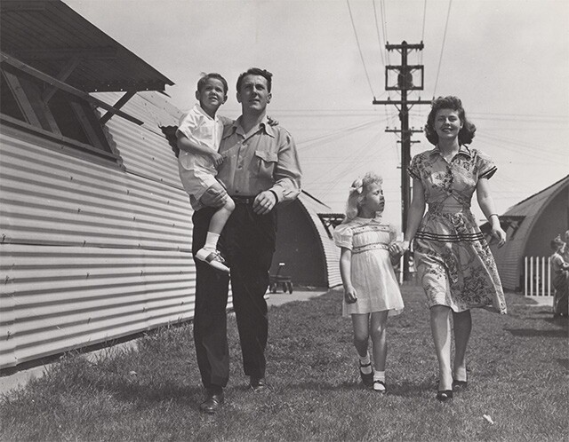 Family of four walk on Roger Young Village green | Housing Authority of the City of Los Angeles