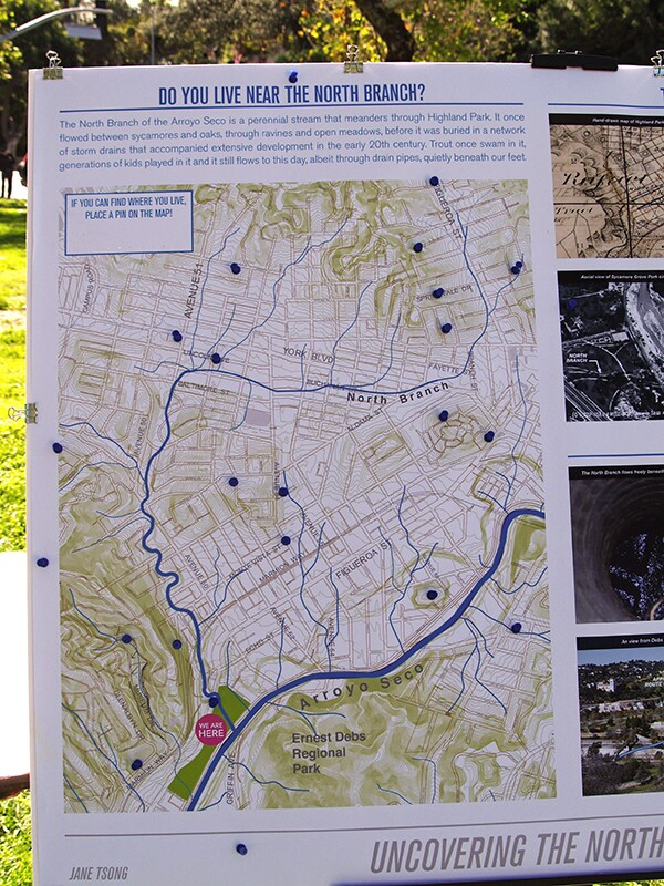 Map of the North Branch as it winds through Highland Park.  Participants at the  Living Museum event were asked to mark where they live along the creek's route. Photo by Jane Tsong. Original posters for event created by Joshua Link.