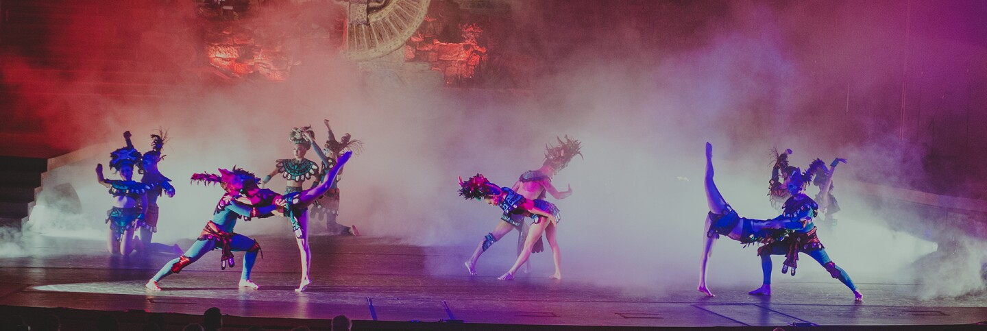 """Journey to Mictlan: Land of the Underworld"" features dancers in colorful outfits creating a vision of a smoky underworld. 
