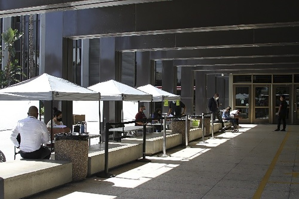 Triage booths are set up outside Orange County Superior Court to allow people to ask questions and interact with courthouse staff without having to go inside.