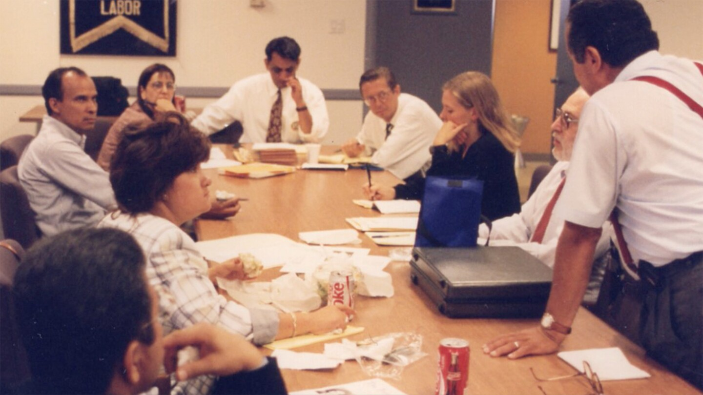 "A young Gil Cedillo at the head of a table discussing plans for an anti-Prop 187 march | Still from ""187"""