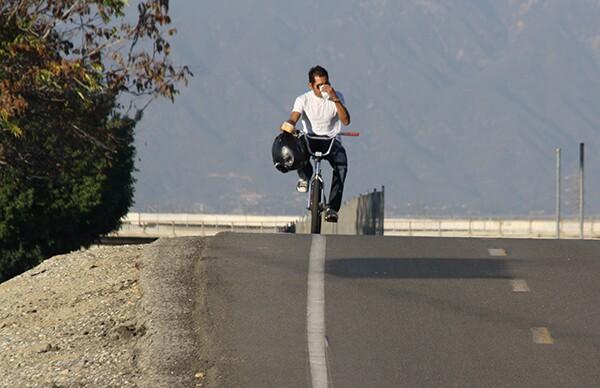 Bicyclist riding on the San Gabriel River Bike Path, Photo by Sarahi S.