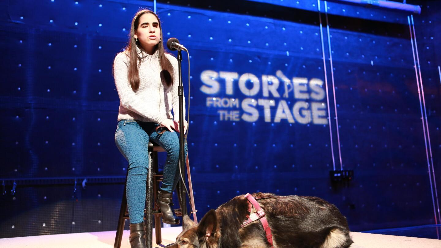"""A girl named Lina sits on a stool as she tells about the love of two dogs that enriched her life after she was left blind. 