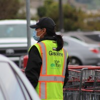 Costco worker in parking lot wearing face mask during COVID-19 pandemic   Karen Foshay