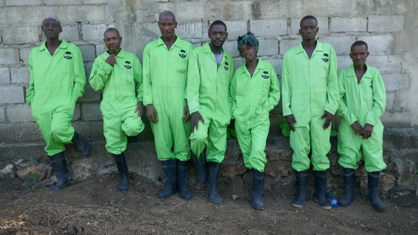 "SOIL employees outside the treatment plant. Port-au-Prince, Haiti, from ""Human: The World Within"""