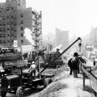 Widening Wilshire Boulevard between Figueroa and Westlake Park. On the left, the Rex Arms apartment building loses its face. Courtesy of the USC Libraries - California Historical Society Collection.