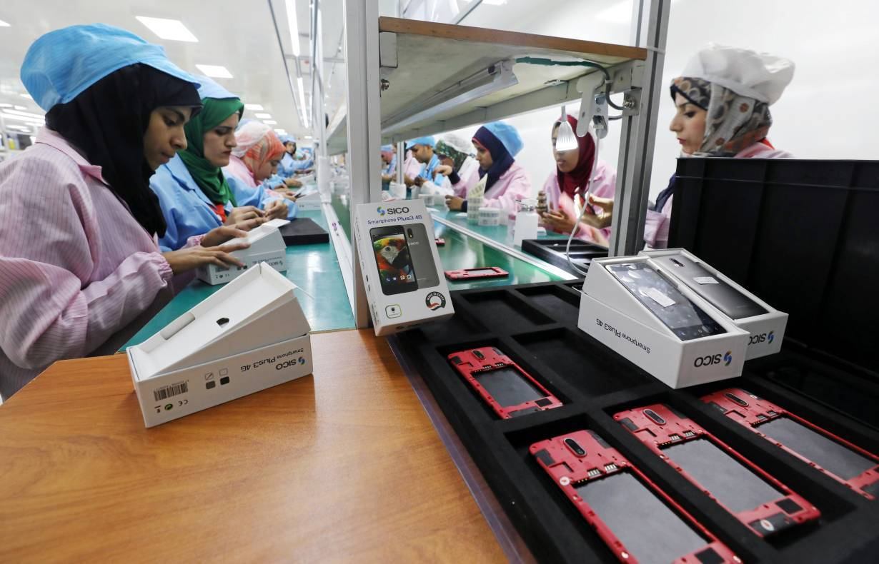 ARCHIVE PHOTO: Women work on a production line at the mobile phone factory in Assuit, Egypt September 30, 2018.   REUTERS/Mohamed Abd El Ghany