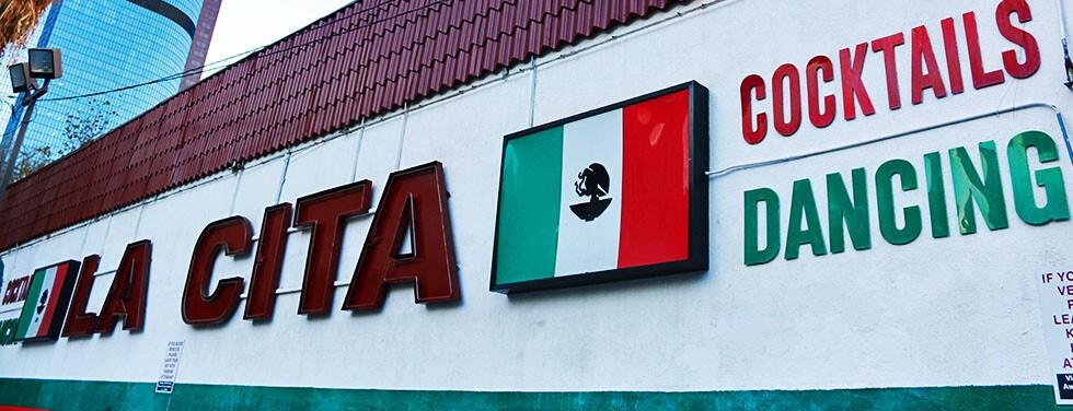 "La Cita Sign with LA skyscraper in the back: Mexican flag, "":Cocktails,"" ""Dancing""   Samanta Helou"