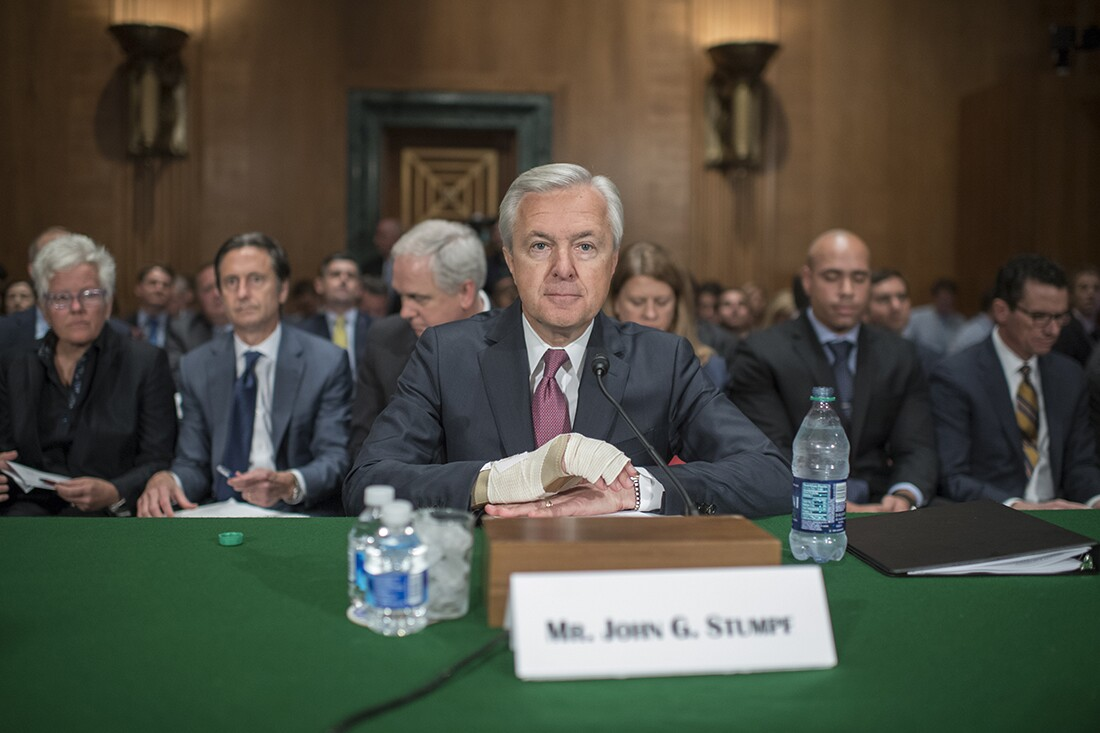 Wells Fargo CEO John Stumpf, center, prepares to testify at a Senate Banking, Housing, and Urban Affairs hearing in Dirksen Building, September 20, 2016, on the company's unauthorized accounts opened under customers' names.   Getty Images