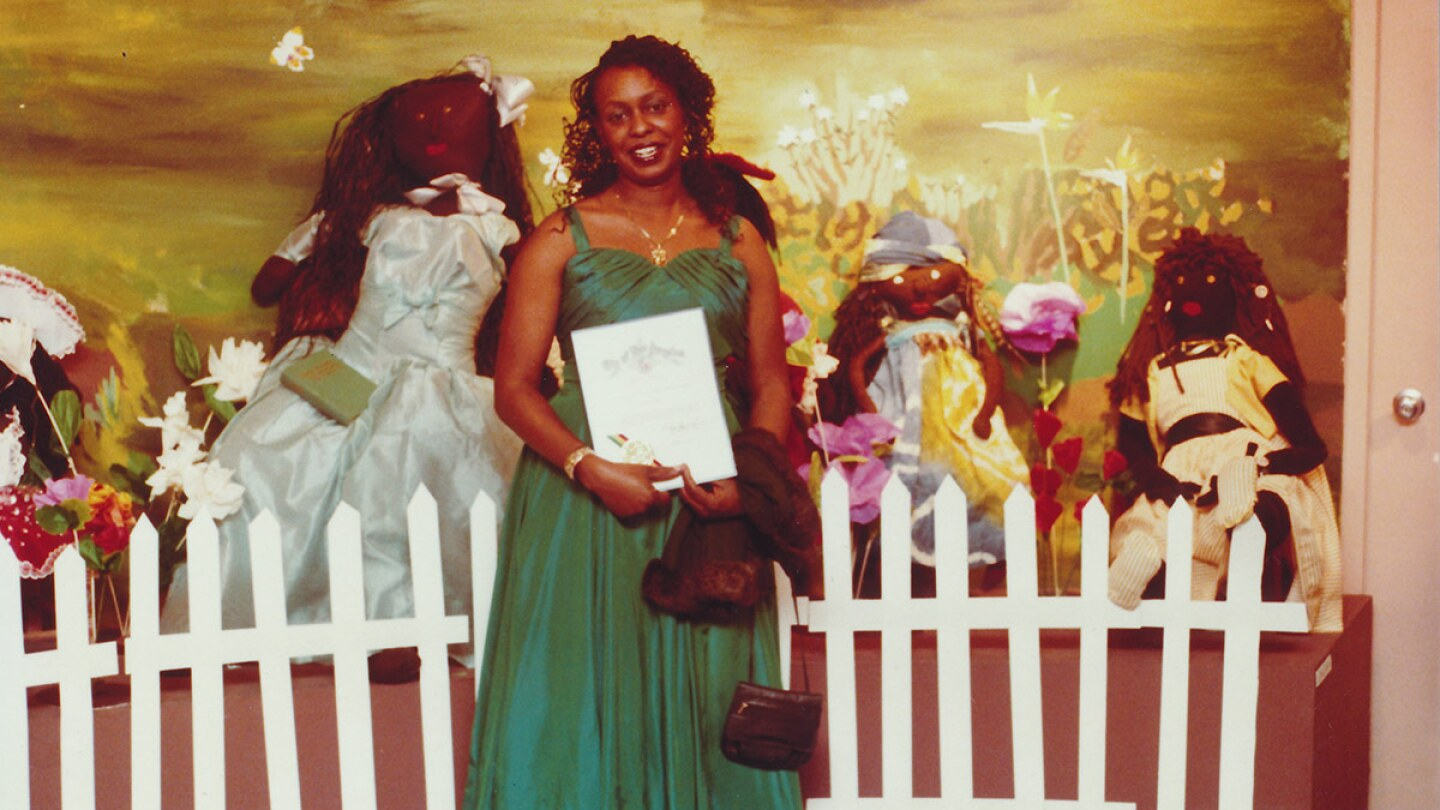 Artist Teresa Tolliver and her installation at a William Grant Still Art Center Black Doll Show, circa 87-90 | Bobbie Campbell, Courtesy of William Grant Still Art Center