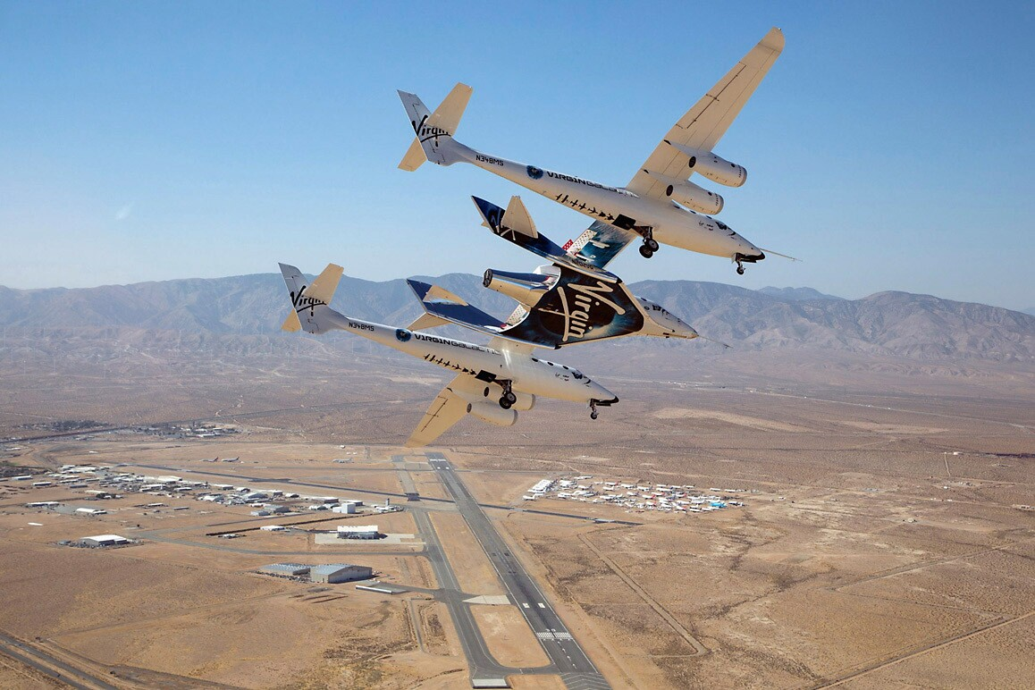 SpaceShipTwo carried by its mothership high above the Mojave Air & Space Port. | Mark Greenburg/Virgin Galactic