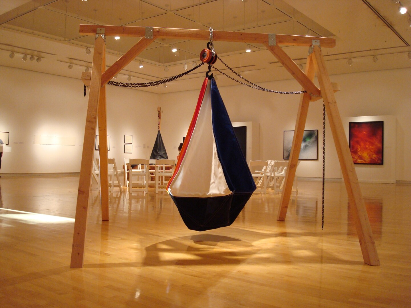 A large sack hangs from a frame.