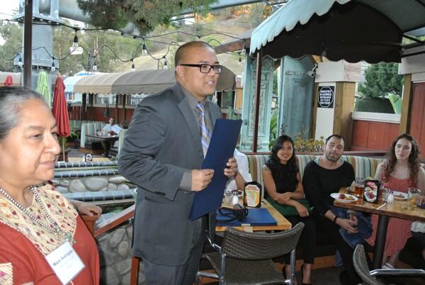 Ryan Carpio (Mayor's Office) and Mary Rodriguez (CD 13) award the interns with city certificates   Photo: Jason Chiang