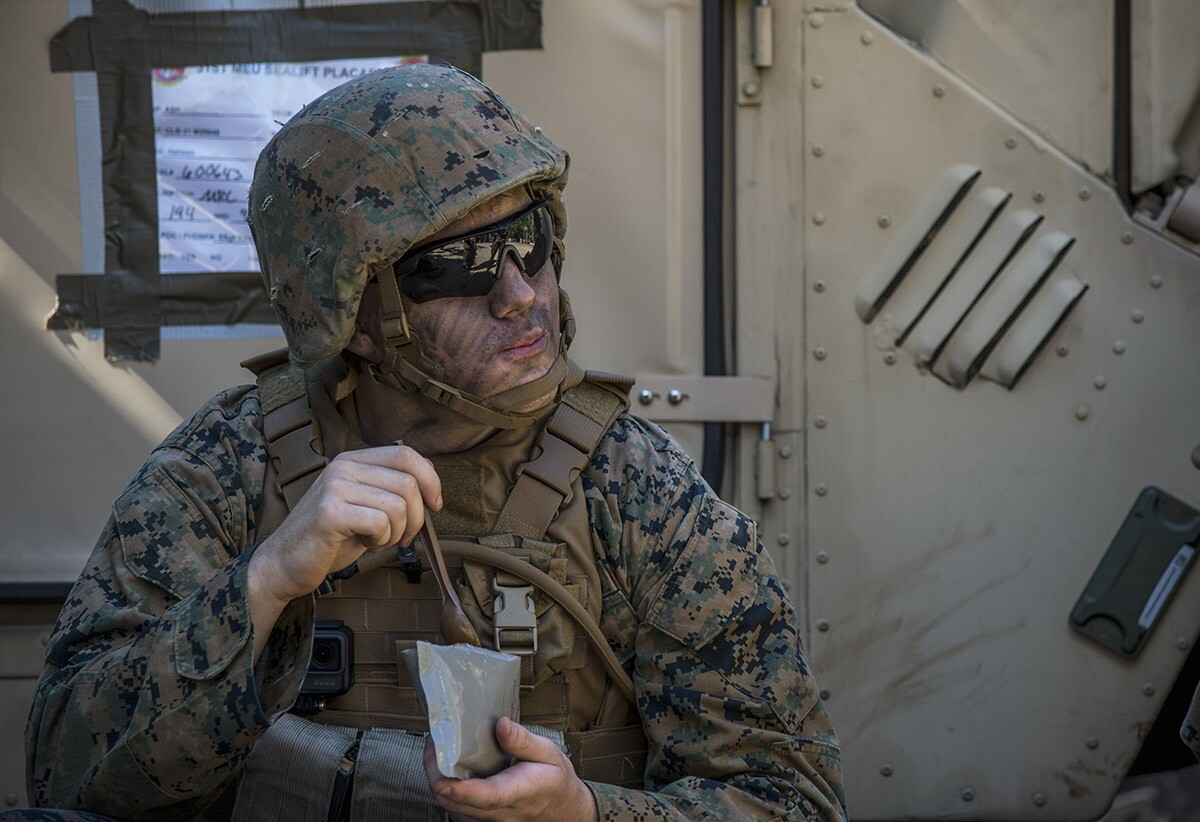 Lance Cpl. Noel Boyland, from Caseyville, Ill. eats an MRE | U.S. Navy photo by Mass Communication Specialist 2nd Class Sarah Villegas/Released