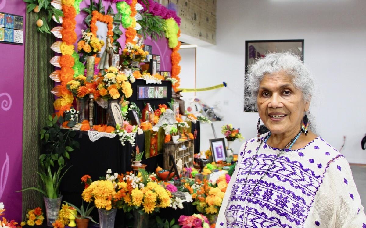 Oferlia Esparza, an altarista, on Dia de los Muertos at Self Help Graphics | Jordan Riefe