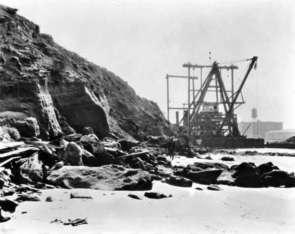 A dredger at work near the shore of Dead Man's Island, circa 1929. Courtesy of the USC Libraries - California Historical Society Collection.