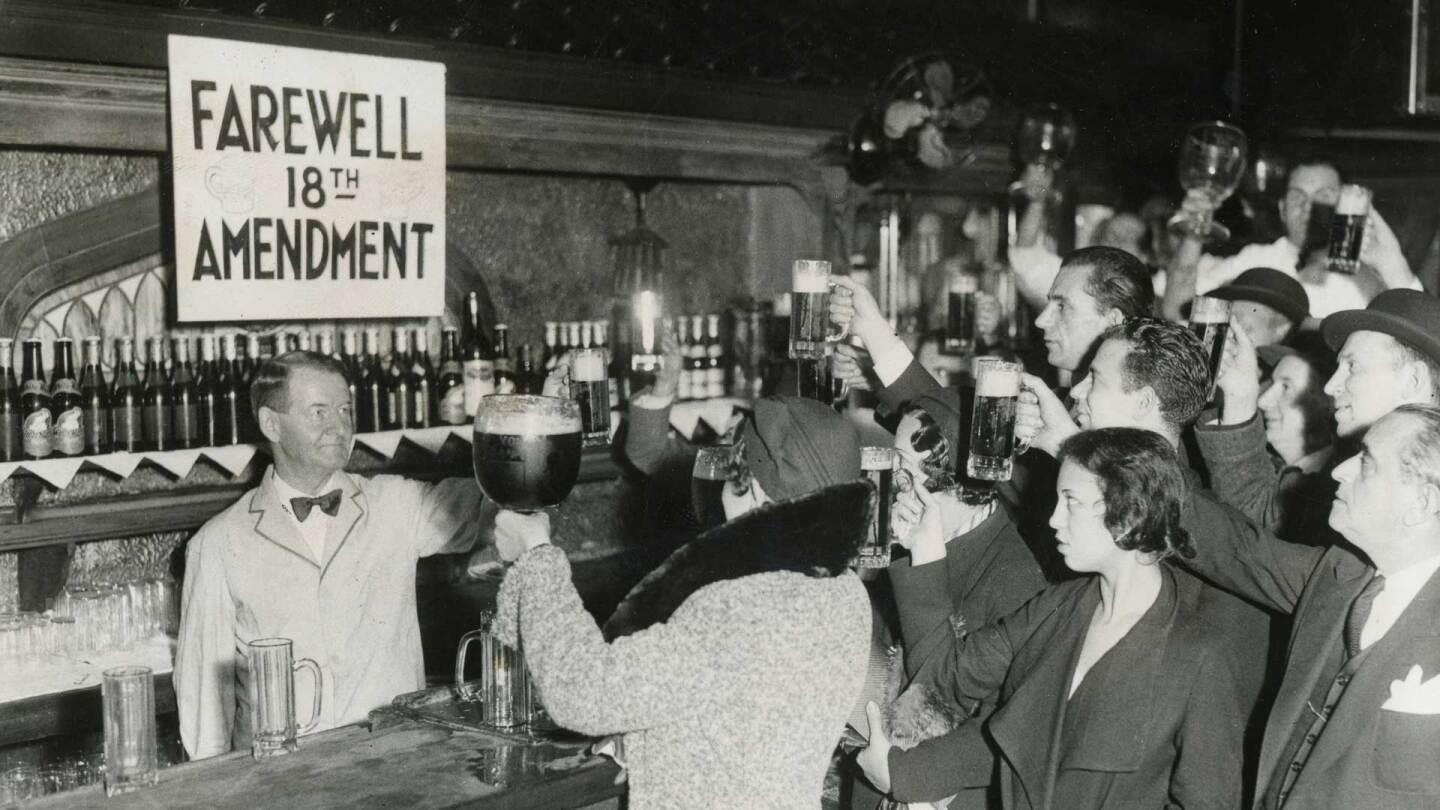 Men and women toasting farewell to the 18th Amendment during Prohibition | Los Angeles Examiner Photographs Collection,University of Southern California Libraries