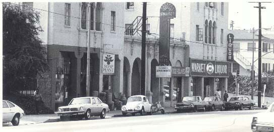 A street view of Sunset Boulevard, the first Soap Plant location. Cars are parked along the street.