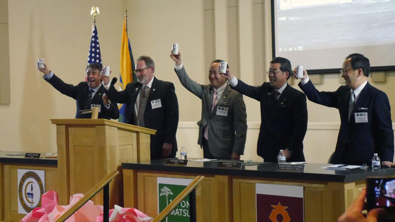 Mayor Inscore leading a toast with sake from Rikuzentakata