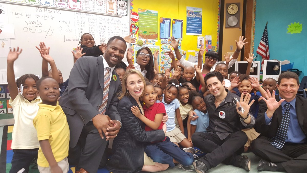 John Lloyd Young of Jersey Boys with students at the school he adopted   Courtesy of the President's Committee on the Arts and the Humanities