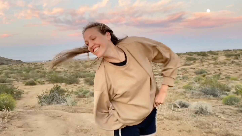 A young woman dances with a desert backdrop for one of Invertigo's Dance Care Package performances | Courtesy of Invertigo