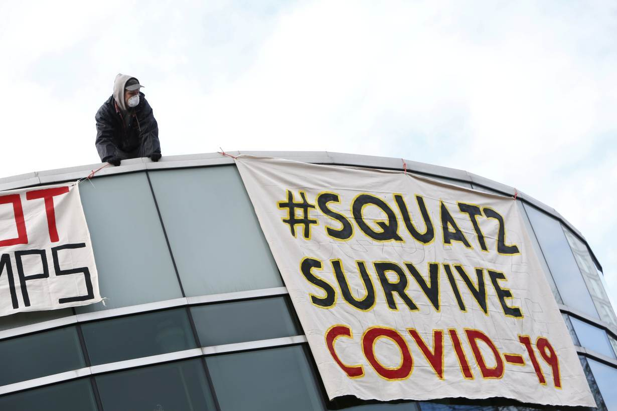 People squat in an empty community center to protest what they describe as a lack of support for the homeless against the coronavirus disease (COVID-19) in Surrey, British Columbia, Canada April 1, 2020.