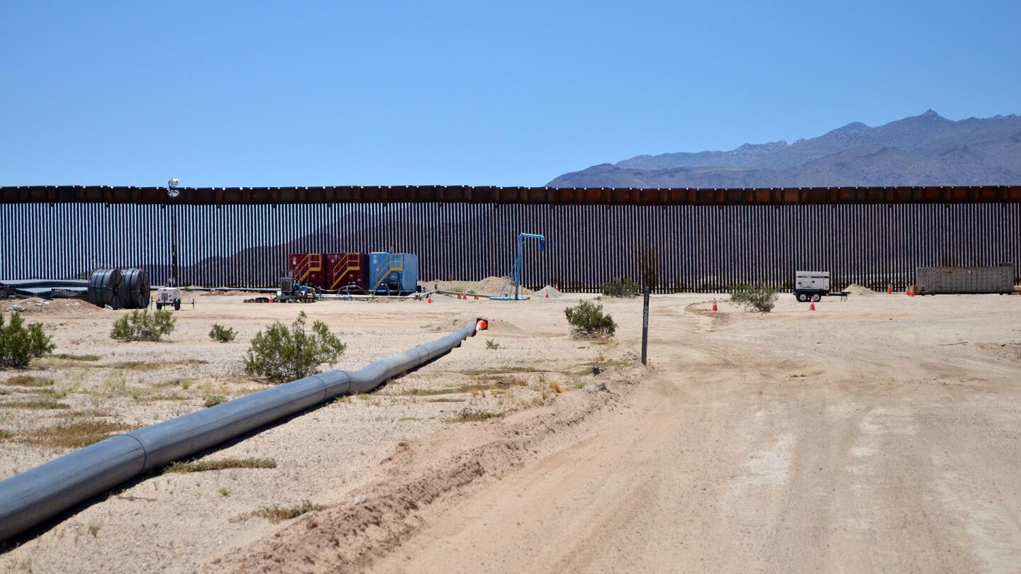 Existing border wall outside the Wilderness on eastern side with the visible pipeline. | Julio Morales