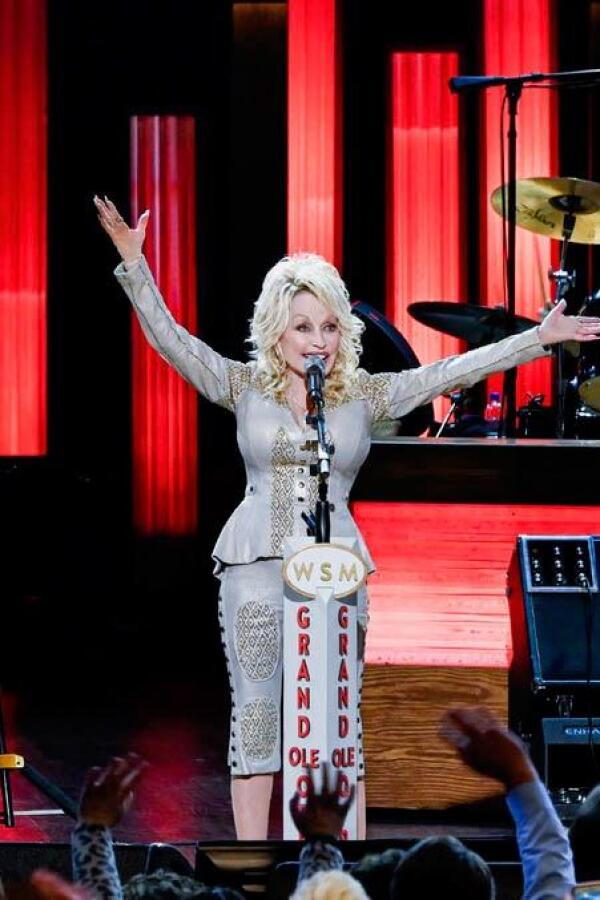 "Dolly Parton outstretches her arms during a performance on stage. | From ""Dolly Parton: I Will Always Love You (My Music)"""