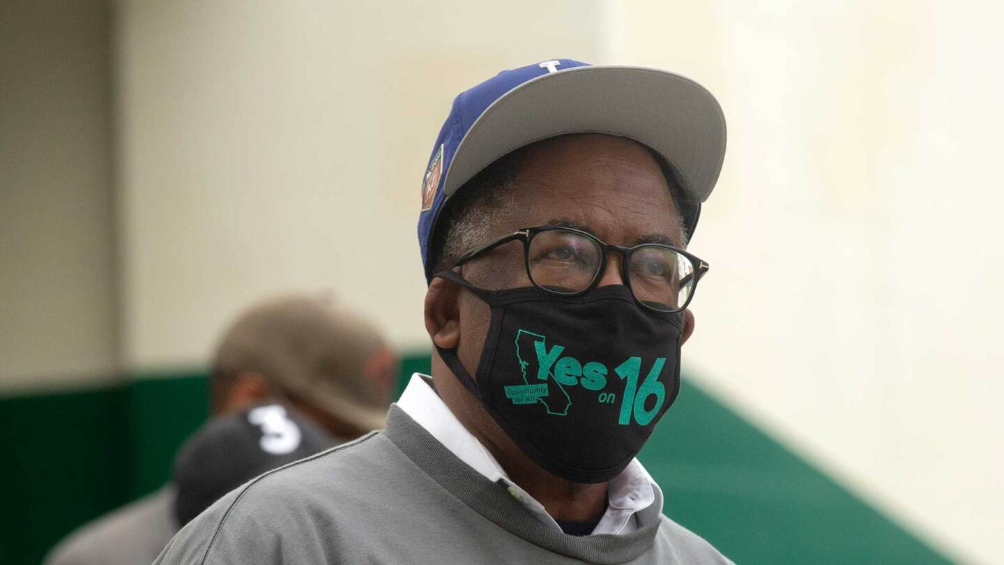 Mark Ridley-Thomas, a newly elected Los Angeles City Council Member, wears a Yes on 16 mask before the election. | Allison Zaucha for The Washington Post via Getty Images