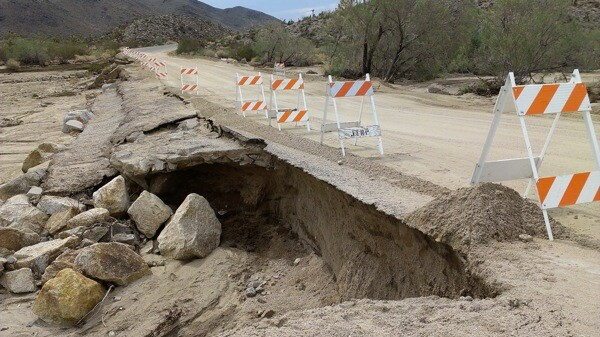 A storm on September 7 damaged a section of the road near the park's North Entrance. | Photo: Courtesy NPS