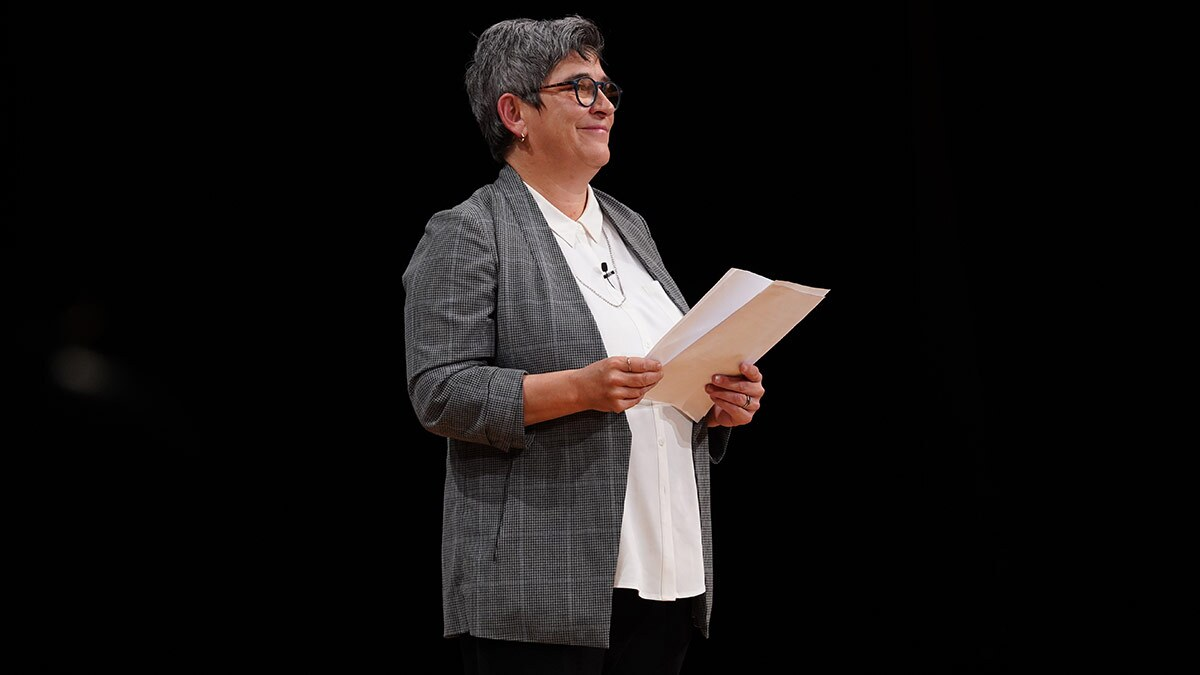 "Kristy Edmunds on stage at a ""10 Questions"" event in 2019. 