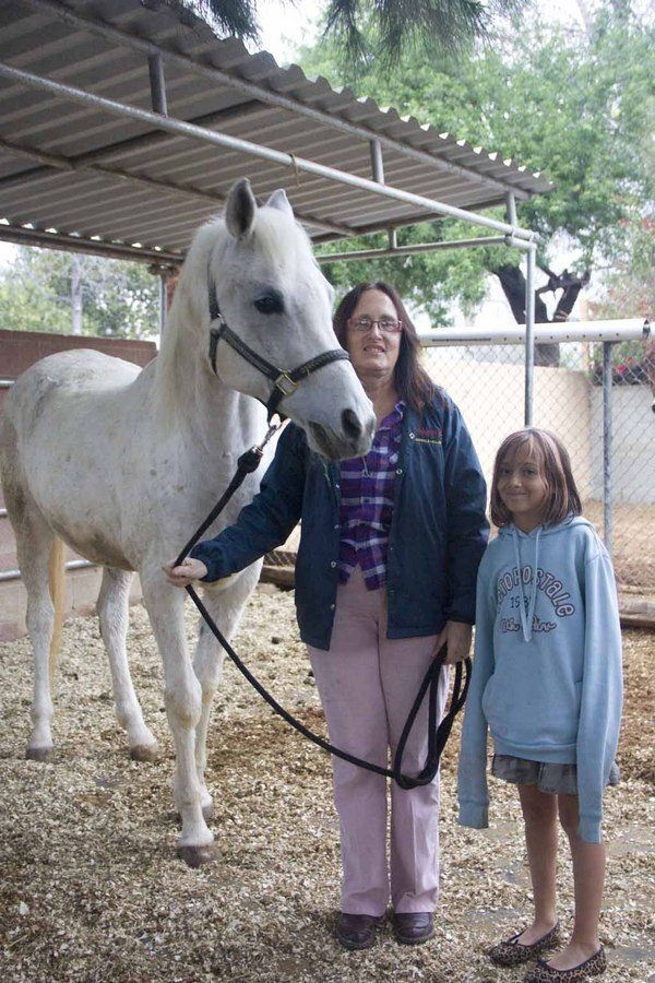 Robinson with her her nine-year old granddaughter Kaela Harris and 17-year-old horse Zacky.
