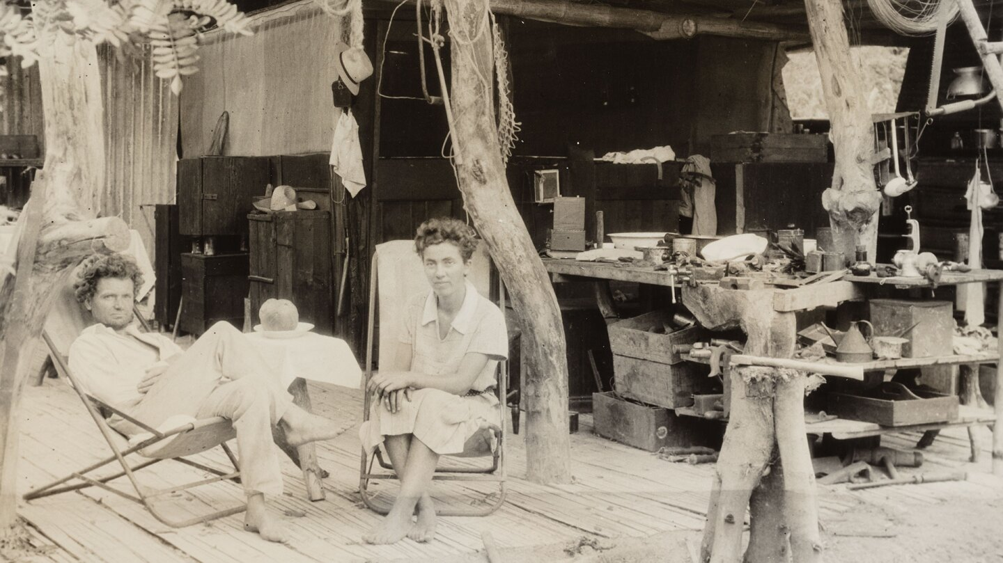 "Dr. Friedrich Ritter (left) and Dore Strauch (right) sitting in their open air home ""Friedo"", on Floreana Island (aka Santa María Island, or Charles Island), Galápagos Islands, Ecuador, 1932 January 1-3. 