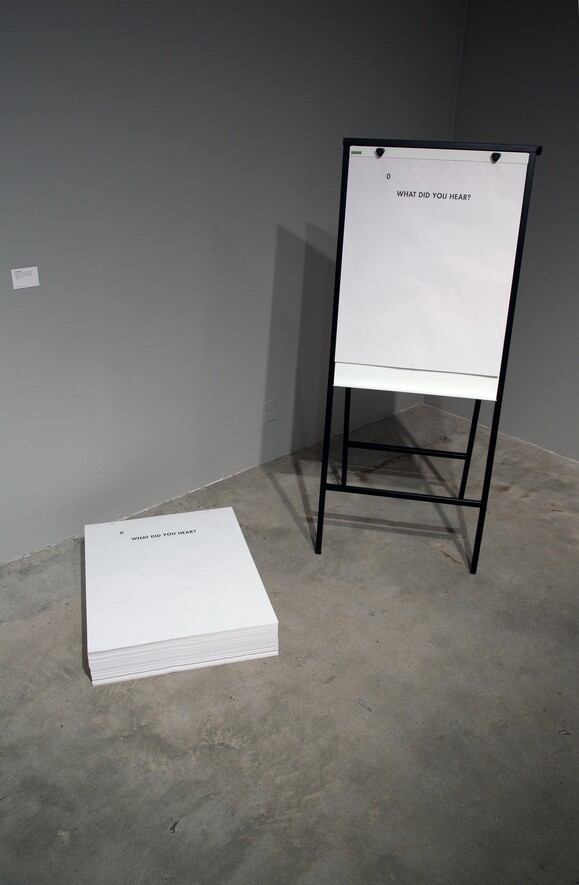 """Ultra-red, """"What did you hear?"""" (2011) Description: installation view, offset print flip-chart tablets, 50 sheets, 27"""" x 34"""", unlimited edition. Los Angeles Municipal Art Gallery. 