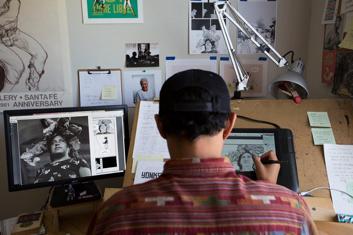 Zeke Pena working on PhotoGRAPHIC: © J. Paul Getty Trust   Sarah Waldorf - Graciela Iturbide exhibition PST LA/LA