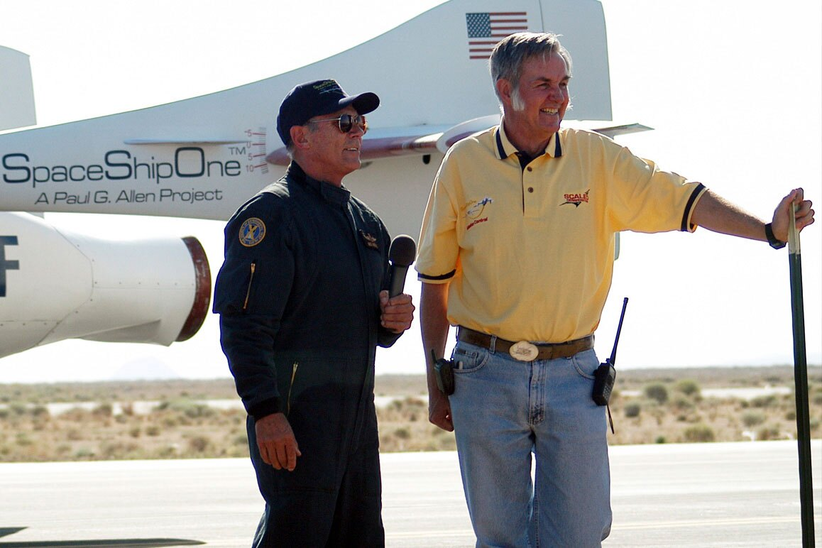 SpaceShipOne astronaut Mike Melvill (left) with Burt Rutan (right) speak to media after the first SS1 flight. | D. Ramey Logan/Wikipedia. (CC BY-SA 3.0)