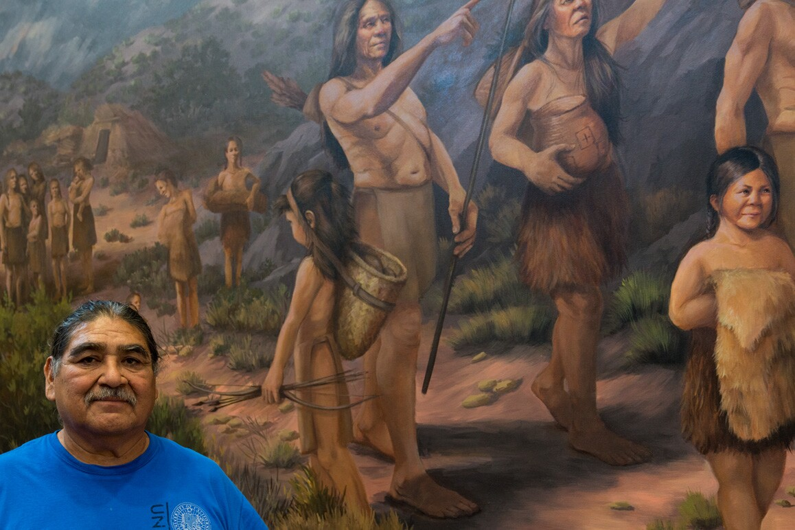 Matt Leivas, Sr. shown in front of a painting representing his ancestors at the Chemehuevi Cultural Center, Havasu Lake, CA. Photo: Kim Stringfellow.