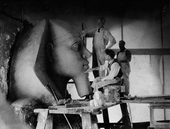 "Workers put the finishing touches on a sphinx on the set of ""The Ten Commandments."" 
