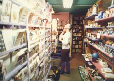 Inside the WACKO/Soap Plant store on Melrose. The walls are a vibrant pink color while the ceiling is green. Various knick-knacks, books and cards line the walls on shelves.