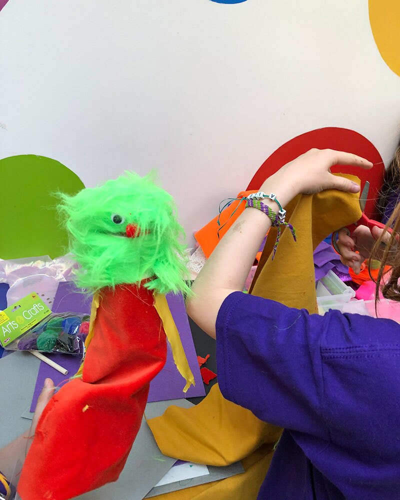 A child makes a puppet at the OxyArts and Kidspace Summer Camp in 2019. | Courtesy of Missy Steele