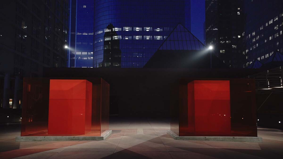 "Larry Bell's ""Bill and Coo at MOCA's Nest"" is a work of Light and Space art. Here it is seen at night. 