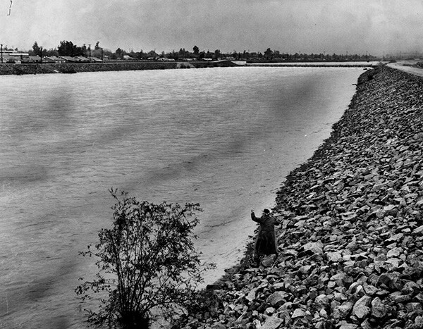 An elderly man fishes off the banks of the San Gabriel River, November 23, 1965 | Courtesy of the Los Angeles Public Library