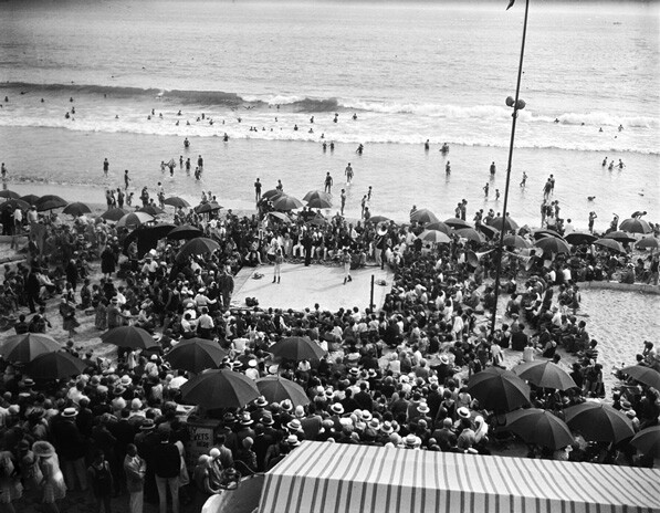 A boxing match takes place on a Southern California beach. From the California Historical Society Collection.