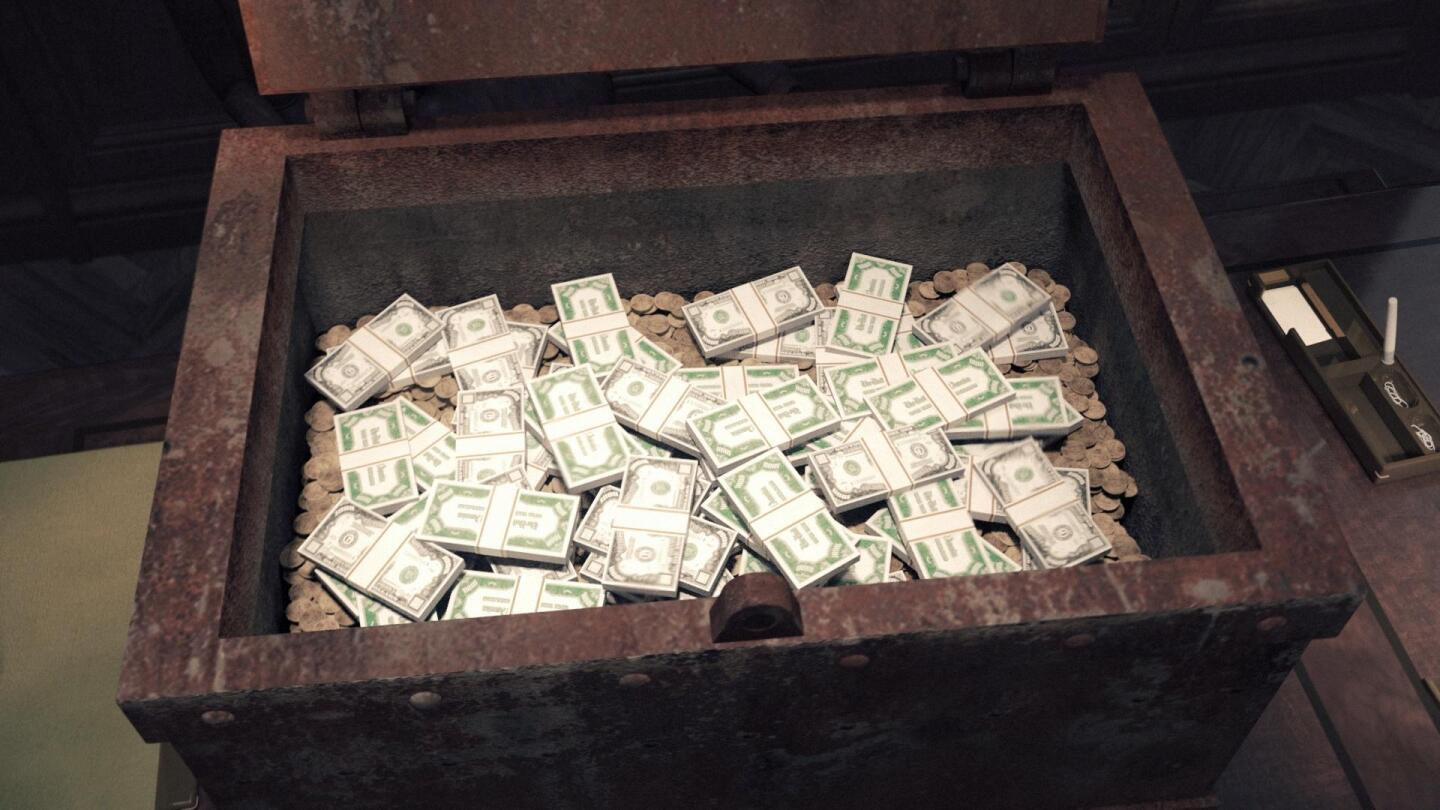 "A chest is filled with stacks of money. | From ""Secrets of the Dead: Gangster's Gold"""