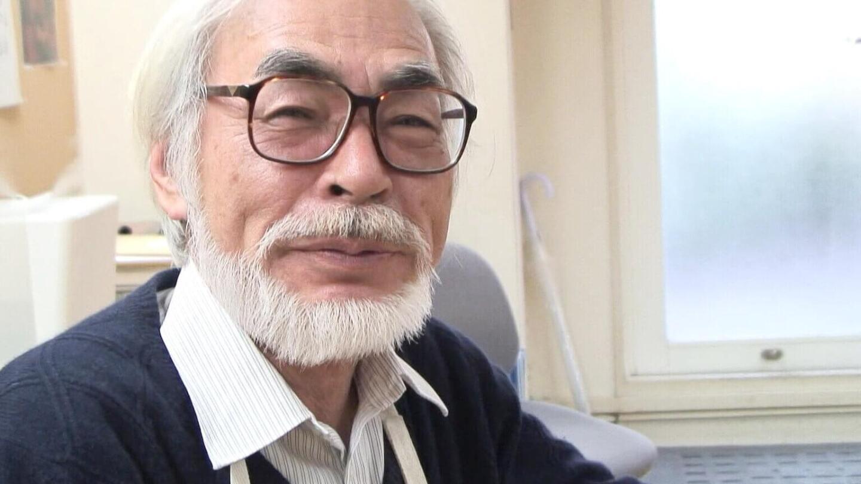 "Hayao Miyazaki smiles sheepishly into the camera. | ""Hayao Miyazaki: 10 Years with the Master - No Cheap Excuses"""