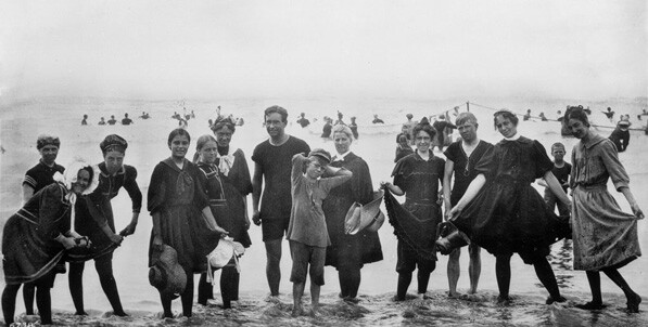 Visitors to Long Beach model their bathing suits, circa 1910.