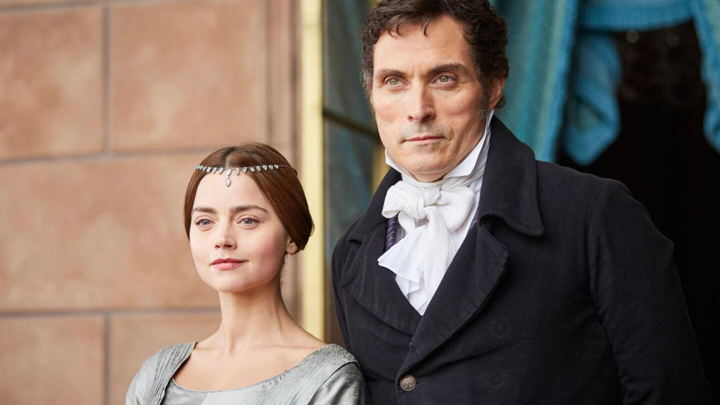 """Queen Victoria (Jenna Coleman) and Lord Melbourne (Rufus Sewell) stand side by side. 